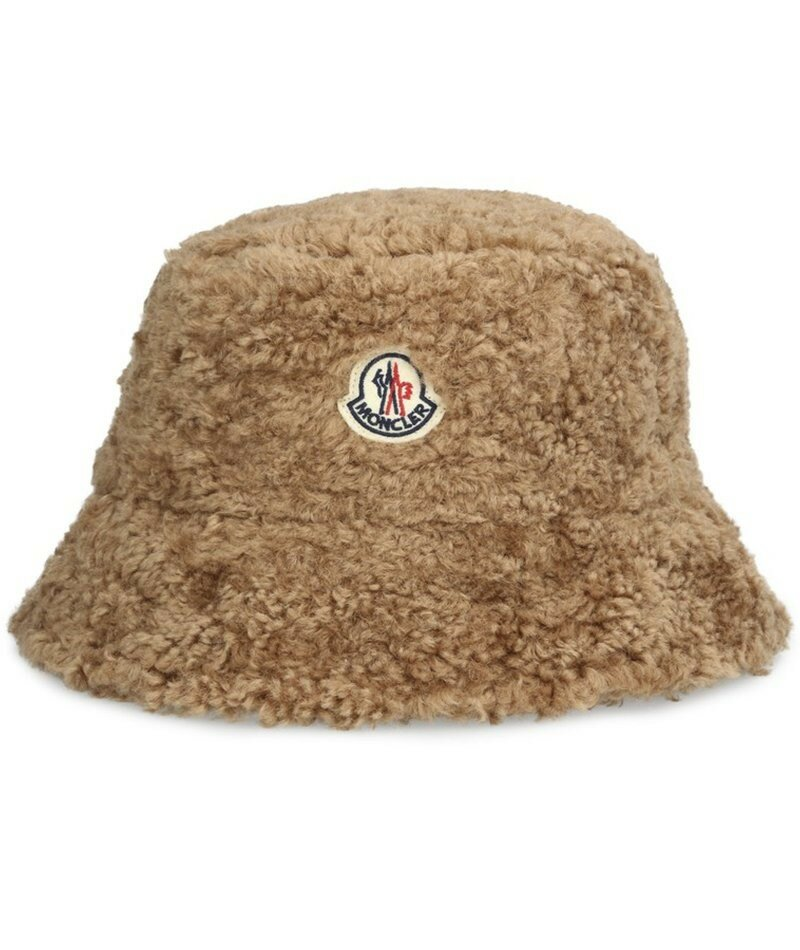 Moncler шляпа. Шапка-ведро Moncler с акцентом на логотипе и ворсованным флисом для тепла и стиля.
